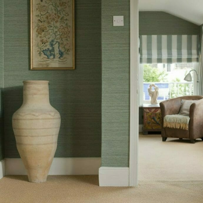 Zoffany Blue Wallpaper with made to measure roman blinds in Romo Fabric.