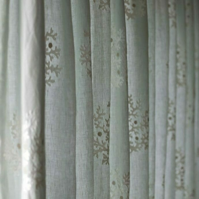 Pinch pleat voile curtain in aqua