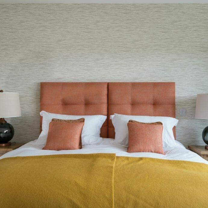 Sanderson Wallpaper against Coral Headboard in St Ives Bedroom