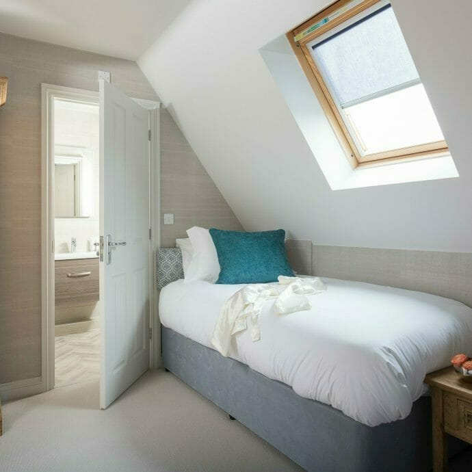 Light Grey Bedroom with Blue Accents in North Cornwall