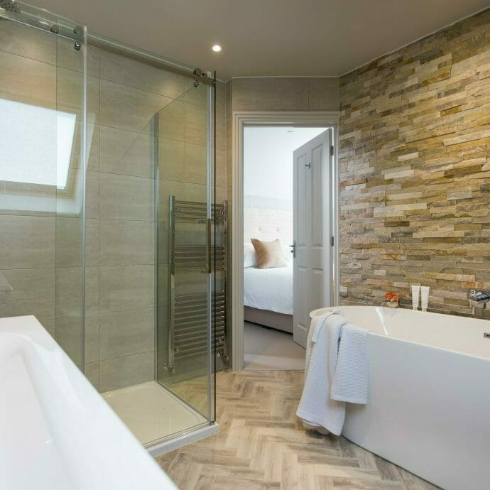 Natural Bathroom with Wood Effect floor tiles. Holiday Home Refurb Cornwall