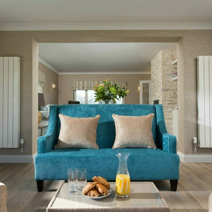 Bespoke Hops and Camellias Teal Blue Sofa in Conservatory in Polzeath.