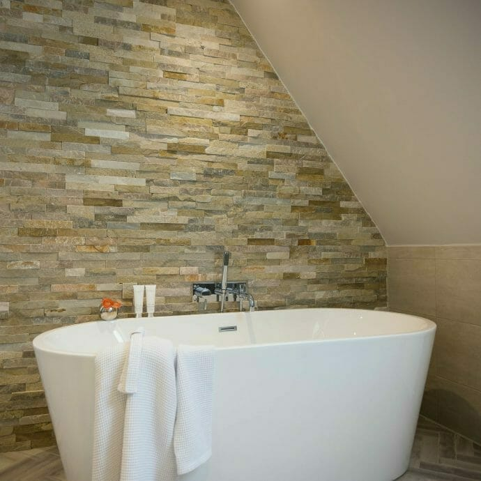 Natural Stone Wall with Freestanding bath in North Cornwall. Holiday Home Refurbishment