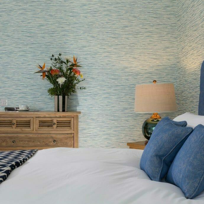 Brunschwig and Fils Herringbone Headboard Fabric with Sanderson Wallpaper Interior Design