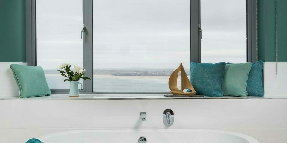 Brunschwig and fils made to order roman blind in bathroom with sea view.