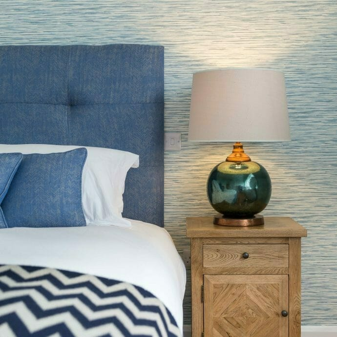 Perfect Blue Coastal Bedroom with Brunschwig and Fils Headboard and cushions