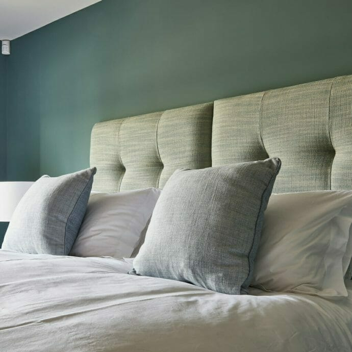Hops and Camellias Interior Design Bedroom with Blue Cushions and Headboard